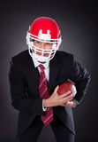 Businessman Holding Rugby Ball Stock Photography