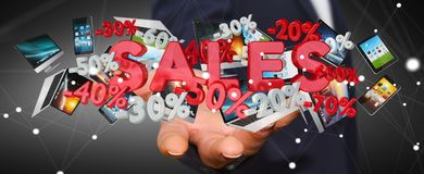 Businessman holding sales icons in his hand 3D rendering. Businessman on blurred background holding sales icons in his hand 3D rendering Royalty Free Stock Photos