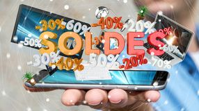 Businessman holding sales icons over his phone 3D rendering. Businessman on blurred background holding sales icons over his phone 3D rendering Stock Photo