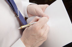 Businessman holding sheet of paper and pen Stock Images