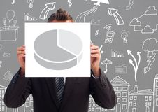 Businessman holding sheet with pie statistics in front of his face with arrows marks on grey backgro Stock Photo