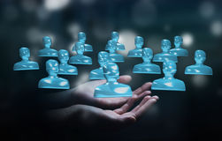 Businessman holding shiny glass avatar group 3D rendering. Businessman on blurred background holding shiny glass avatar group 3D rendering Royalty Free Stock Photos