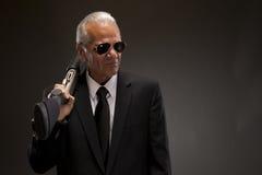 Businessman holding shotgun Royalty Free Stock Photos