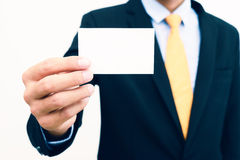 Businessman holding and showing blank business card isolate on white background Stock Images