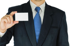 Businessman is holding or showing blank white card  over white background. Stock Images