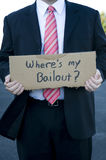 Businessman holding a sign. That says where's my bailout Stock Image