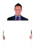 Businessman Holding A Sign Royalty Free Stock Images