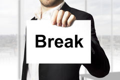 Businessman holding sign break Stock Images