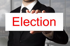 Businessman holding sign election Royalty Free Stock Image