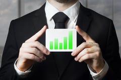 Businessman holding sign green bar diagram Royalty Free Stock Photo