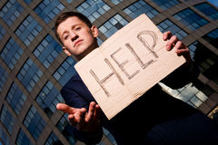 Businessman holding sign Help outdoors. Financial crisis. Unemployment. Businessman holding sign Help outdoors Royalty Free Stock Photography