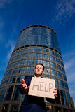 Businessman holding sign Help outdoors. Financial crisis. Unemployment. Businessman holding sign Help outdoors Royalty Free Stock Photos