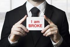 Businessman holding sign i am broke Stock Image
