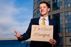 Businessman holding sign I am good Manager Stock Images