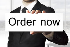 Businessman holding sign order now Royalty Free Stock Photo