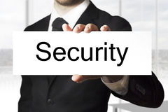 Businessman holding sign security Royalty Free Stock Image