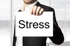 Businessman holding sign stress Royalty Free Stock Photography