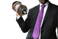 Businessman holding silver dumbbell Royalty Free Stock Photography