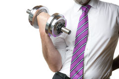 Businessman holding silver dumbbell Royalty Free Stock Photos