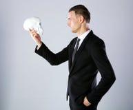Businessman holding skull Royalty Free Stock Photography