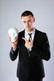 Businessman holding skull Stock Image