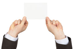 Businessman holding small blank card Stock Photography