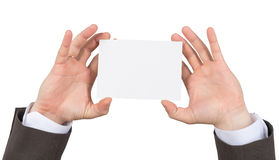 Businessman holding small blank paper Royalty Free Stock Images