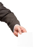 Businessman holding small blank paper Royalty Free Stock Photo