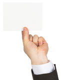 Businessman holding small empty card Royalty Free Stock Photo