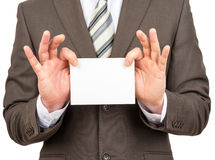 Businessman holding small empty paper Stock Photo