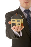 Businessman Holding Small House Stock Photo