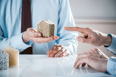 Businessman Holding Small House Model in Meeting Stock Photography