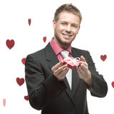 Businessman holding small red gift Royalty Free Stock Photo