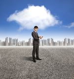 Businessman holding smart phone with cloud computi Royalty Free Stock Images