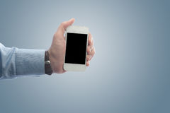 Businessman holding a smart phone Stock Images