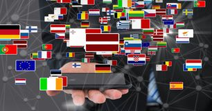 Businessman holding smart phone with various flags and connecting dots Stock Photography
