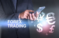Businessman holding smart phone world of currency forex trading Stock Photography
