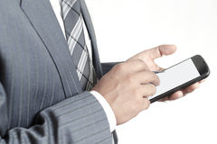 Businessman holding smartphone with blank screen Stock Photos