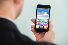 Businessman Holding Smartphone With Colorful Application Royalty Free Stock Photography