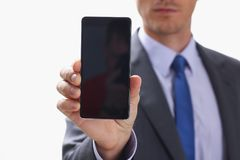 Businessman holding smartphone in hand Royalty Free Stock Photos