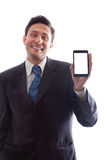 Businessman holding a smartphone and smiling Stock Photography