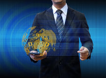 Businessman holding smartphone world technology Royalty Free Stock Photo