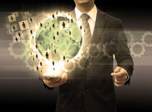 Businessman holding smartphone world technology and social media Stock Photos