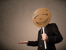 Businessman holding a smiley face board Royalty Free Stock Photos