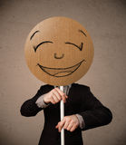 Businessman holding a smiley face board Royalty Free Stock Images