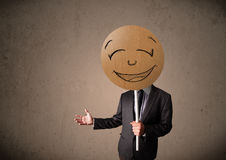 Businessman holding a smiley face board Stock Image