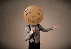 Businessman holding a smiley face board Royalty Free Stock Image