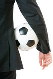 Businessman holding soccer ball Stock Photography