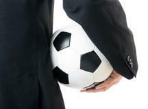 Businessman holding soccer ball Stock Image