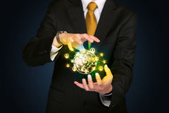 Businessman holding a social media globe Stock Photos